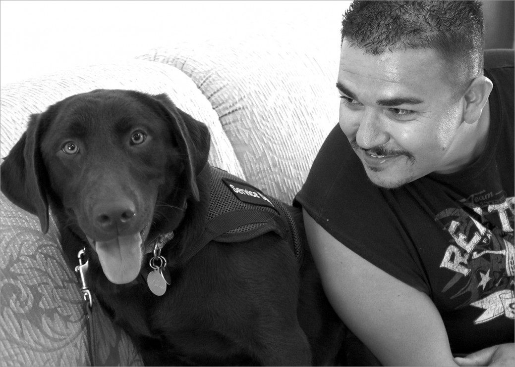 US Marine Corps veteran Felipe with his service dog Kachina in training at Operation Freedom Paws.