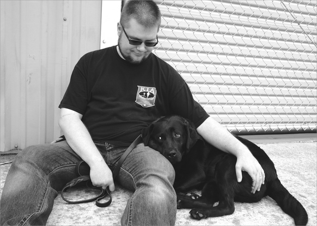 US Army veteran Bazyli with his service dog Kameza training at Operation Freedom Paws. Kameza is constantly by Bazyli's side, alerting him to the onset of pain and reminding him to sit down and take break.
